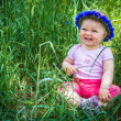 Royalty-Free Stock Photo: Cute infant baby girl sitting in grass