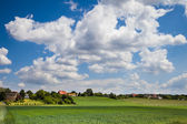 Rural landsape with fields and village — Stock Photo