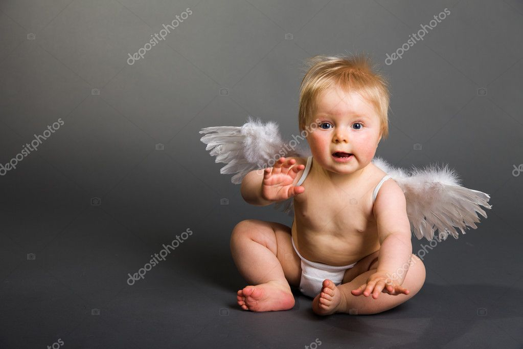 Infant baby with angel wings on neutral background — Stock Photo #10997260