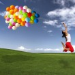 Jumping with balloons — Stock Photo #11786807