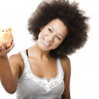 Woman with a piggy bank — Stock Photo #11786980