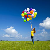 Girl with colorful balloons — Stock Photo