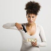 Shooting money — Stock Photo