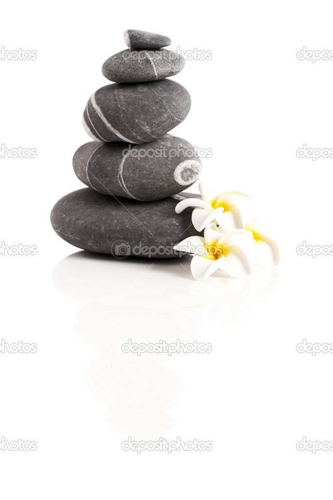 Stones pyramid with a plumeria flower, isolated on white background — Stock Photo #11786952