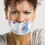 cobrindo a boca com uma nota de euro — Fotografia Stock  #12317455