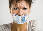 Covering mouth with a euro banknote — Stock Photo