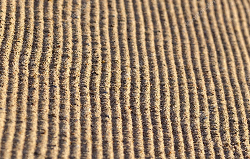 Detail of some traces in the sand.  Stock Photo #11413363