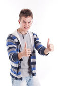 Young man thumbs up — Stock Photo