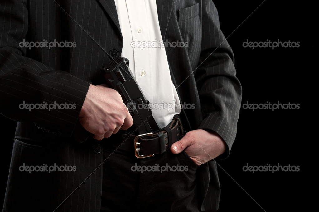 Gun in trousers, isolated on black — Stock Photo #10773273