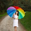 Girl posing with umbrella — Stock Photo
