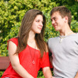 Stock Photo: Couple sitting on park bench