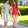 Young couple walking in park — Stock Photo #11072702