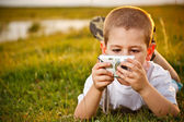 Boy with the camera — Stock Photo