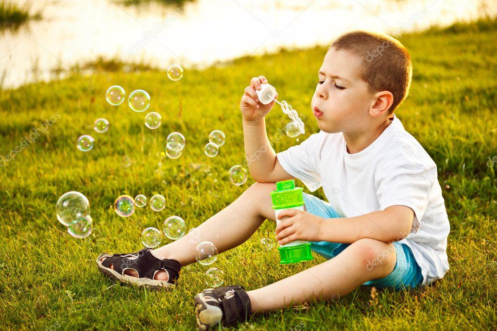 Kid Blowing Soap Bubbles Boy Blowing Soap Bubbles