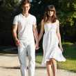 Couple walking in park — Stock Photo #11264912