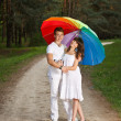 Young couple in the summer rain — Stock Photo