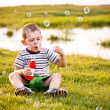 Boy blowing soap bubbles — Stock Photo #11264978