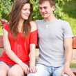 Young teen couple on a bench — Stock Photo