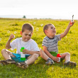 Boys blowing soap bubbles — Stock Photo #11307093