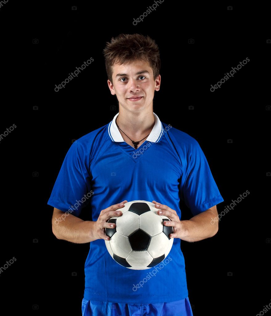 Soccer player is holding ball on black background — Stock Photo #11444289