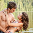 Young couple in lake water — Foto Stock