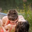 Young couple on the shore — Stock Photo #11529206