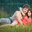 Young couple on the shore — Stock Photo