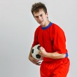 Young soccer player holding a ball — Stock Photo #11529313