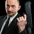 Man holding a gun — Stock Photo