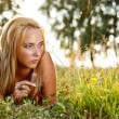 Young female lying on grass — Stock Photo