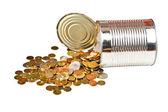 Monety i może — Zdjęcie stockowe