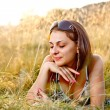Beautiful womlying in grass — Stock Photo #11739983