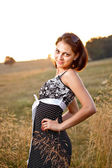 Adorable woman in field — Stock Photo
