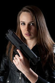 Woman with gun — Stok fotoğraf