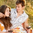 Стоковое фото: Young couple in the field