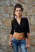Fashion model in jeans — Stock Photo