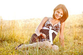Young woman sitting on the grass — Stock Photo