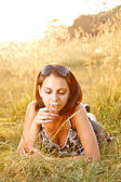 Young girl in summer field — Stock Photo