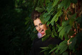 Fashion model woman in forest — Stock Photo