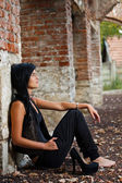 Young woman sitting — Stock Photo