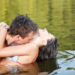 Couple are kissing in the water — Stock Photo