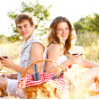 Young couple sitting — Stock Photo