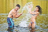 Couple playing in the water — Stock Photo