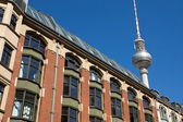 Old building with television tower — Stock Photo