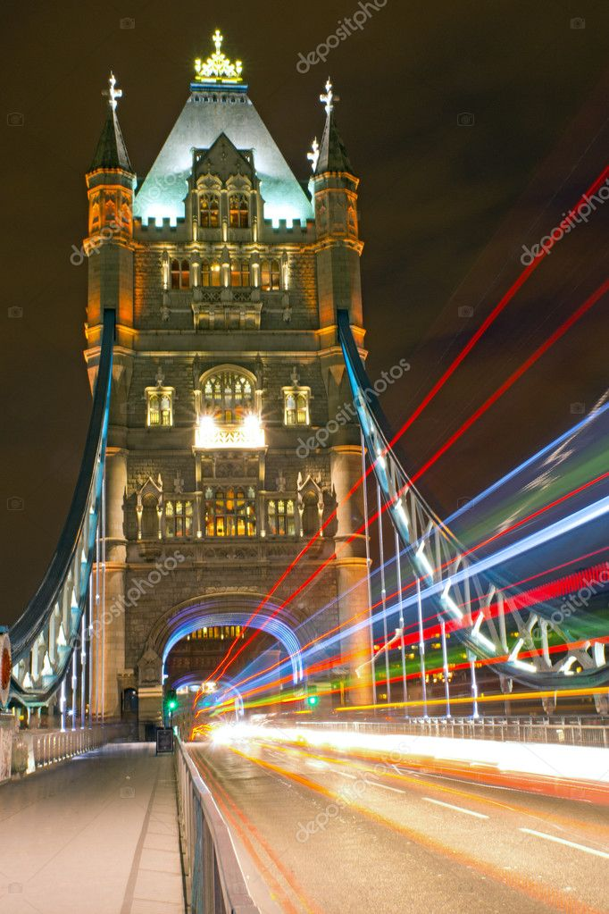The illuminated Tower Bridge in London with traffic lights — Stock Photo #10943947