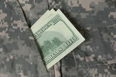 Uniform with a banknote — Stock Photo
