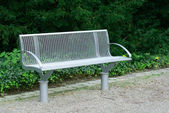 Garden bench in the park — Stock Photo