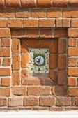 Tiles on a brick wall — Stock Photo