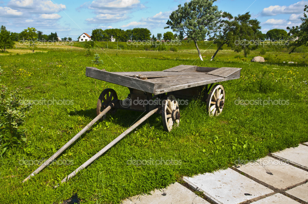 An old wooden wagon in the meadow — Stock Photo #11857899