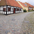 Cobbled street ebeltoft village denamrk — Stock Photo